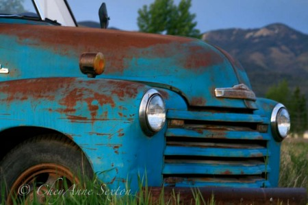 front bumper of the old blue chevy pickup